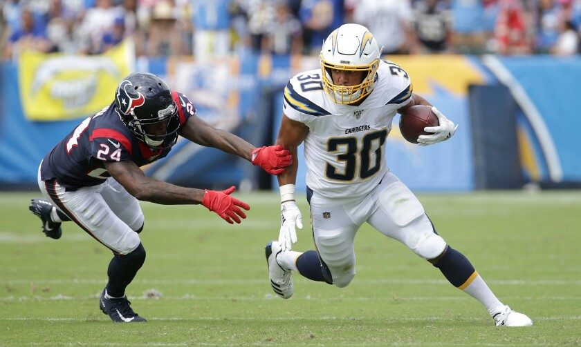 Chargers running back Austin Ekeler carries the ball against the Texans.