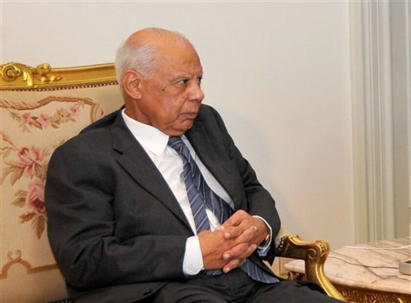 In this image released by the Egyptian Presidency, Hazem el-Beblawi meets with interim President Adly Mansour, unseen, in Cairo, Egypt, Tuesday, July 9, 2013. The spokesman of Egypt's interim president says a prominent economist, Hazem el-Beblawi, has been named prime minister and pro-democracy leader Mohamed ElBaradei as a vice-president. Ahmed el-Musalamani made the announcements Tuesday after days of political stalemate over the prime minister post. El-Beblawi, who is in his 70s, served as fi