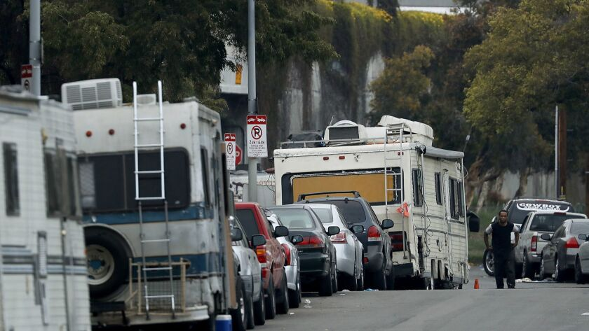 LOS ANGELES, CALIF. - MAY 22, 2018. Motorhomes sit along Grand Avenue in South Los Angeles, where