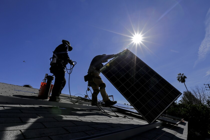 The number of solar installations, such as this Sunrun project in Van Nuys, continue to increase but the pace of growth is slowing.