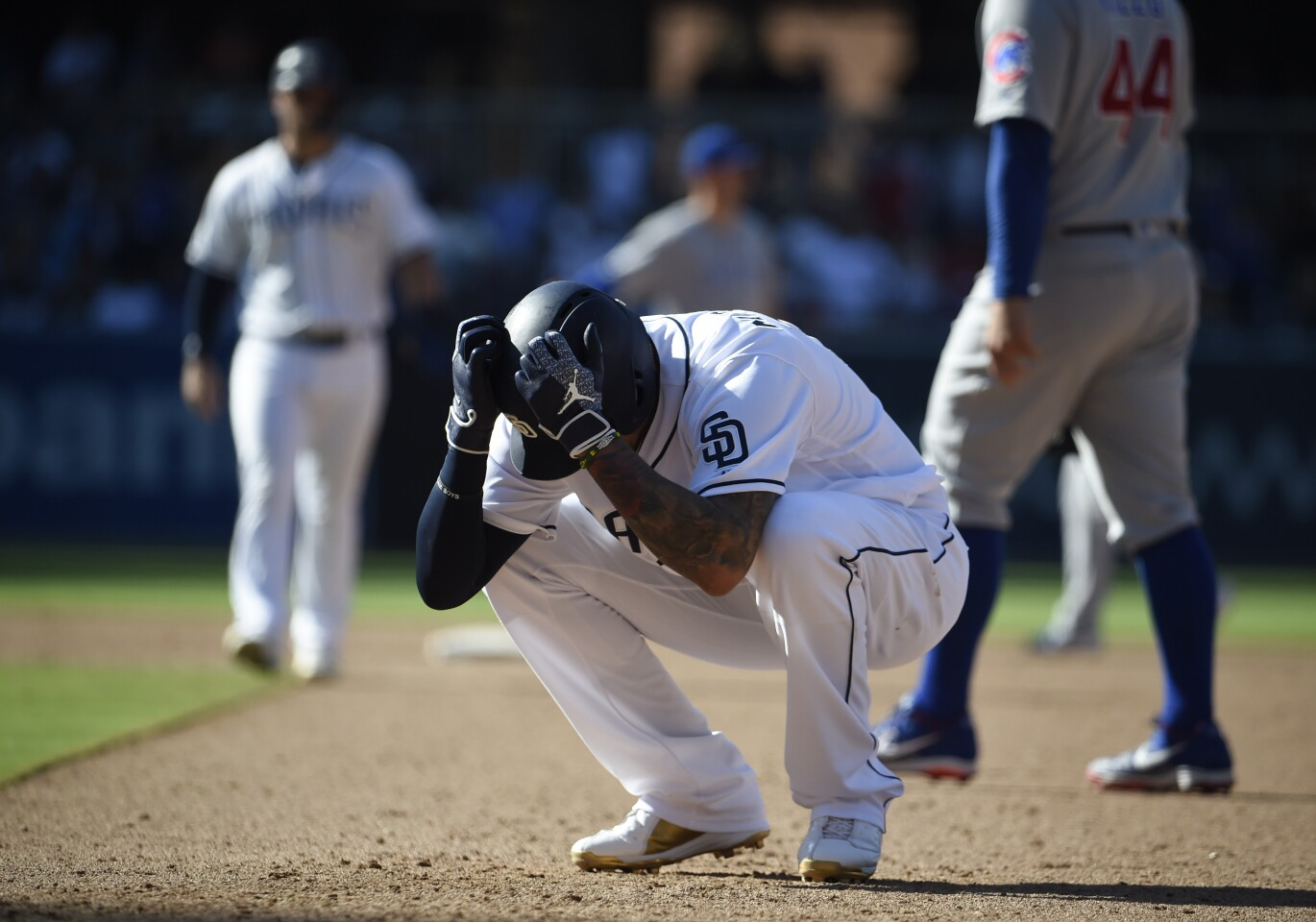 SAN DIEGO, CA - SEPTEMBER 12: Manny Machado #13 of the San Diego Padres reacts after the Padres lost the 4-1 to the Chicago Cubs in a baseball game at Petco Park September 12, 2019 in San Diego, California. (Photo by Denis Poroy/Getty Images) ** OUTS - ELSENT, FPG, CM - OUTS * NM, PH, VA if sourced by CT, LA or MoD **