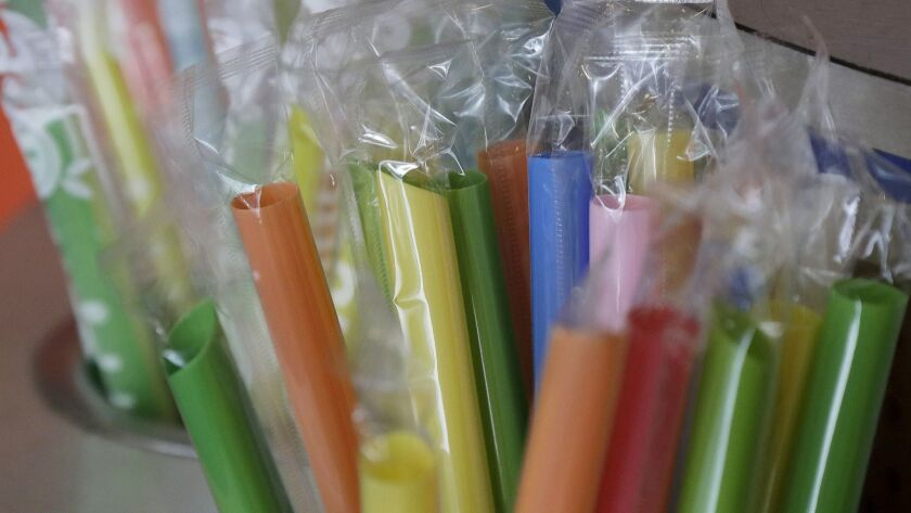 This July 17, 2018 photo shows wrapped plastic straws at a bubble tea cafe in San Francisco. Eco-con