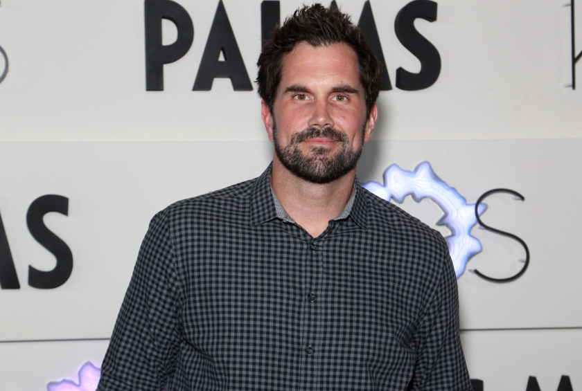 Matt Leinart stands, hands in pockets, in front of a sign at Palms Casino Resort on April 5, 2019, in Las Vegas.
