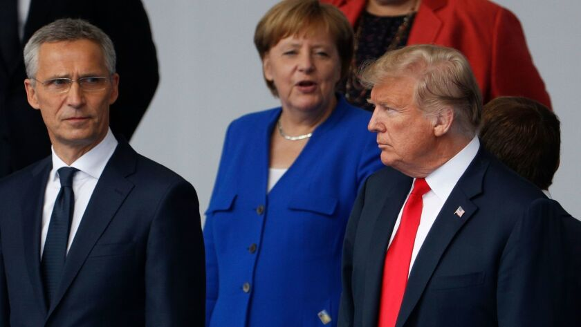 """NATO Secretary-General Jens Stoltenberg, German Chancellor Angela Merkel and President Trump at the """"family photo"""" session ahead of the opening ceremony of the NATO summit in Brussels."""
