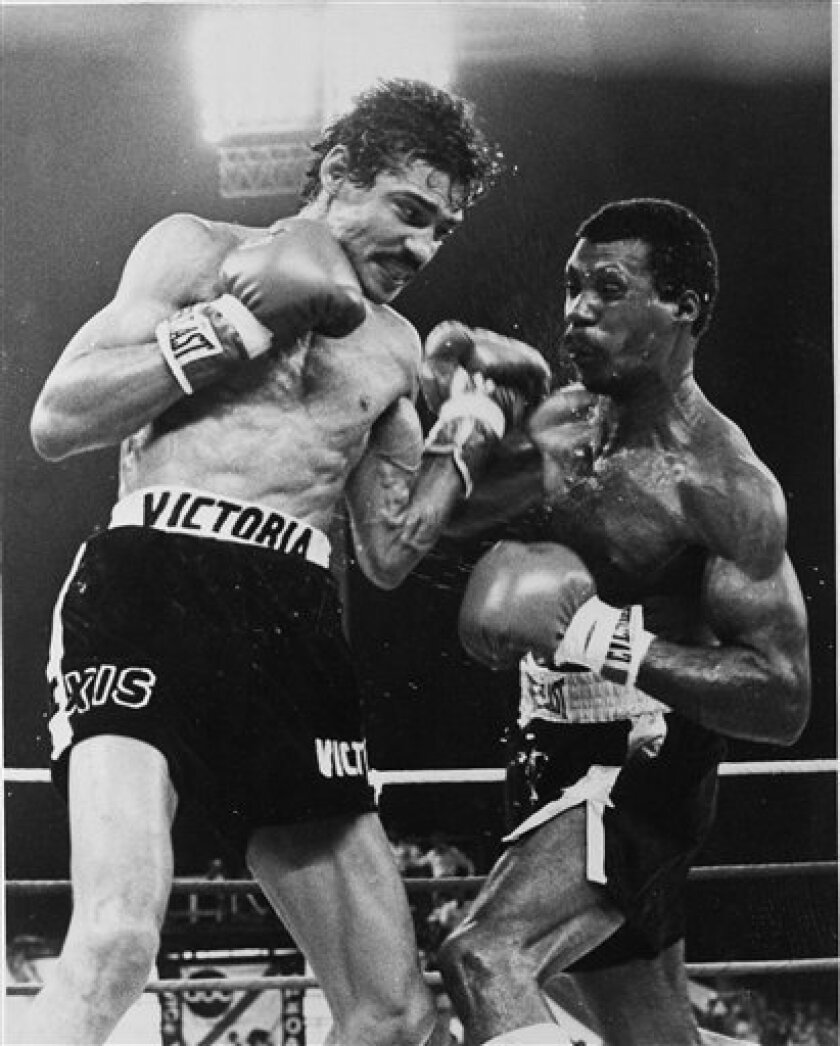 FILE - In this Jan. 28, 1978 file photo, Nicaragua's junior lightweight fighter Alexis Arguello, left, cuts into Puerto Ricos' Alfredo Escalera with a strong left in the ninth round of their World Boxing Council title fight near San Juan. Arguello, three-time world boxing champion, who once fought against the Sandinistas in the 1980s, but joined the party to win election as mayor of Managua in 2008, was found dead Wednesday, July 1, 2009, presidential spokeswoman Rosario Murillo said. (AP Photo, File)