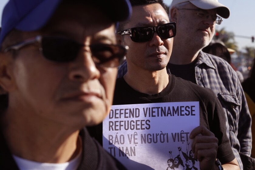 WESTMINSTER, CA - DECEMBER 15, 2018 - - Hoang Ly, 43, center, joins members of the Little Saigon com