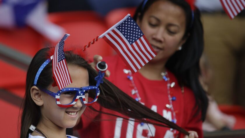 US fans wait on the stand for the start of the Women's World Cup Group F soccer match between United