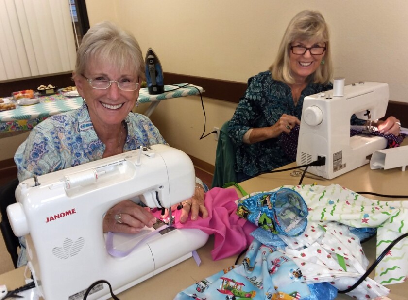 SAN MARCOS: Volunteers sew for Operation Smile Members of GFWC Contemporary Women of North County recently got together for their quarterly Sew-In at the San Marcos Community Center. The group sewed more than 50 hospital gowns that will be donated to 'Operation Smile,' a nonprofit that sends teams of medical volunteers around the world to perform surgery on children born with cleft palate and other facial deformities. From left to right, members Judy Jackson and Kathy Shattuck work on hospital gowns. Visit cwonc.org.