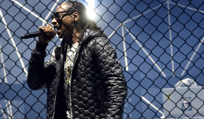 Snoop Dogg performs on the runway during the Philipp Plein Show in Milan, Italy.