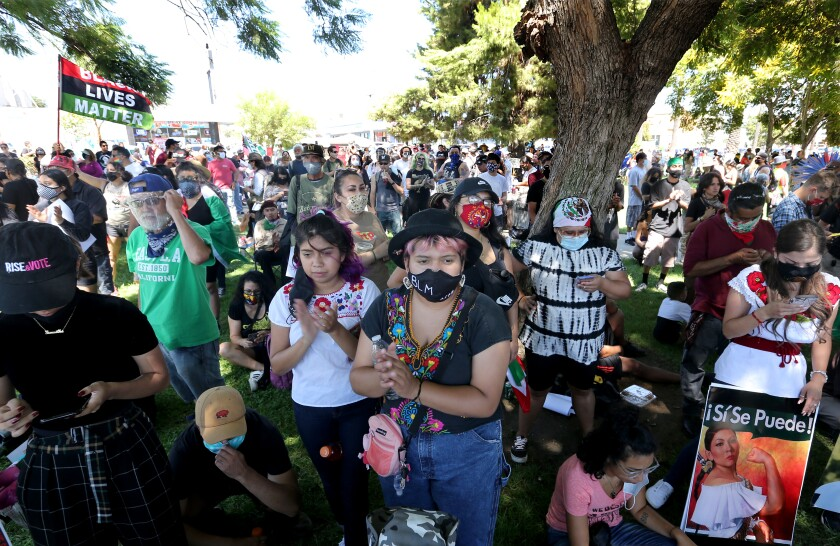 Hundreds of people gather in Ruben Salazar Park in Los Angeles