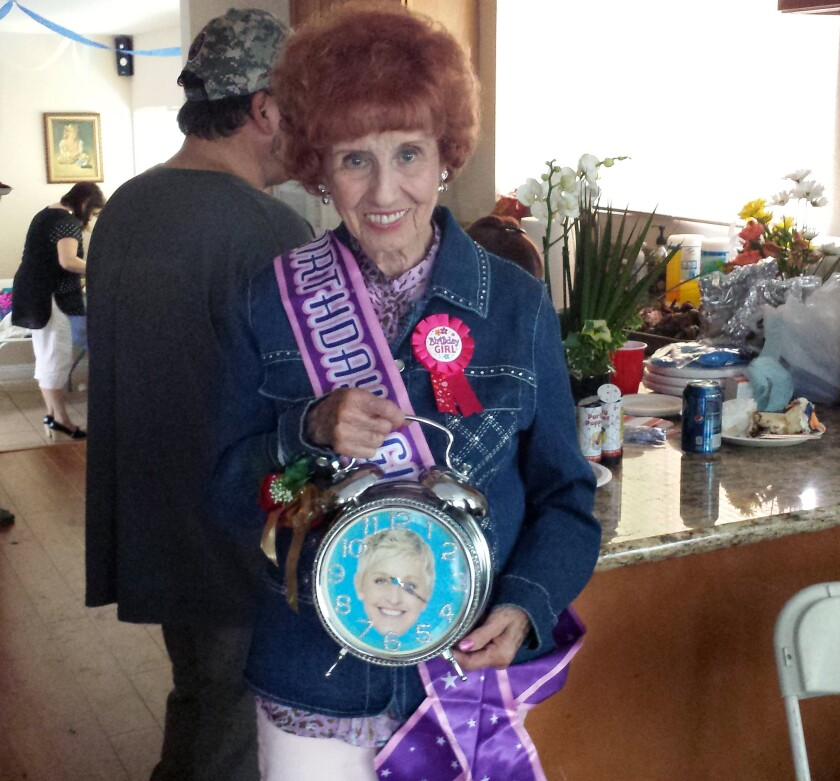 """Elinor Otto, a """"Rosie the Riveter"""" who still works for Boeing, at her surprise 94th birthday party with the clock given to her on the """"Ellen"""" show."""