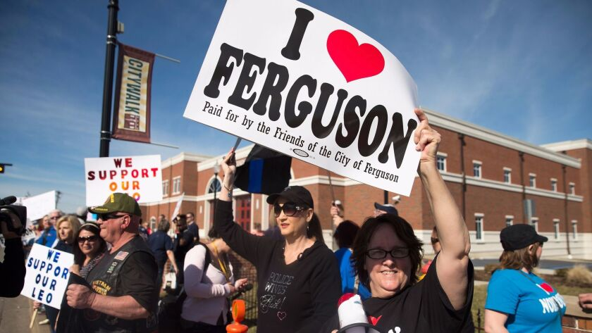 Police supporters rally in Ferguson, Mo., in 2015 after two police officers were wounded by gunfire in the unrest following the fatal shooting of Michael Brown. Jeffrey Williams was convicted of the shootings Friday.