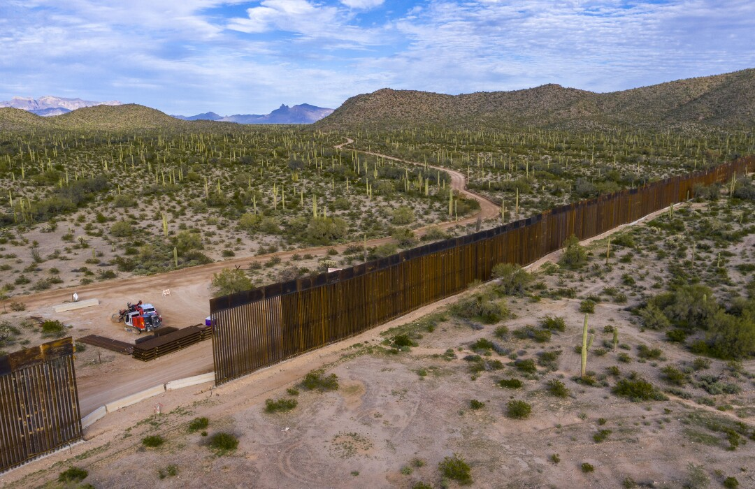 Aerial view from the town of Sonoyta, Mexico, of border wall construction west of Lukeville, Ariz. Crews are widening a border road to 60 feet, uprooting cactuses and other plants to make way for a new border wall to replace a vehicle barrier.
