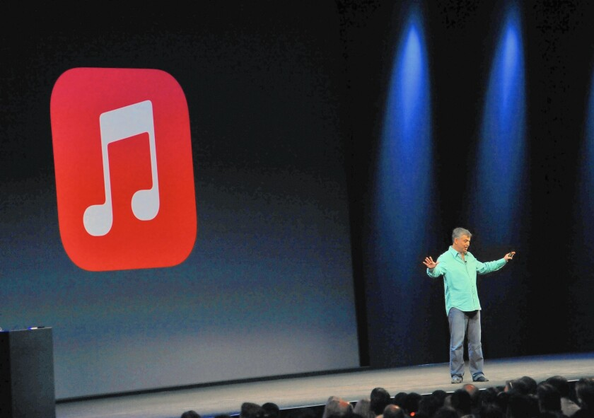 The recording industry is hoping Apple brings subscription-only streaming to the masses. Above, Apple executive Eddy Cue introduces iTunes Radio in 2013.