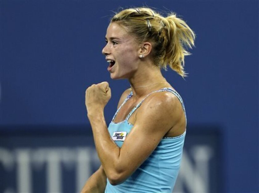 Camila Giorgi, of Italy, pumps her fist after defeating Caroline Wozniacki, of Denmark, during the third round of the 2013 U.S. Open tennis tournament, Saturday, Aug. 31, 2013, in New York. (AP Photo/Charles Krupa)