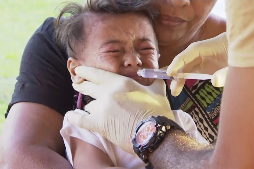 A child is vaccinated at a health clinic in Apia, Samoa, earlier this month.