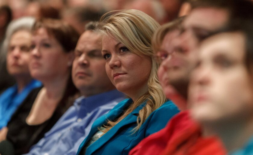 FILE - In this Nov. 30, 2012, file photo, Elissa Wall attends a community meeting regarding the United Effort Plan (UEP) trust,  in Colorado City, Ariz. The Utah Supreme Court is weighing a lawsuit filed by Wall who says polygamous leader Warren Jeffs forced her to marry her cousin when she was 14.