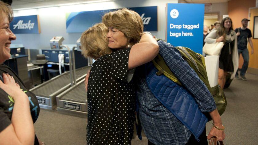 Sen. Lisa Murkowski, right, gets a hug from Mandy Odenheimer, Alaska Airlines' Sitka airport manager