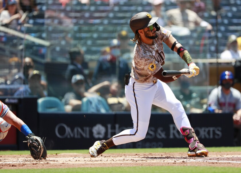 Fernando Tatis Jr. tried to check his swing in the first inning of Sunday's game against the Mets