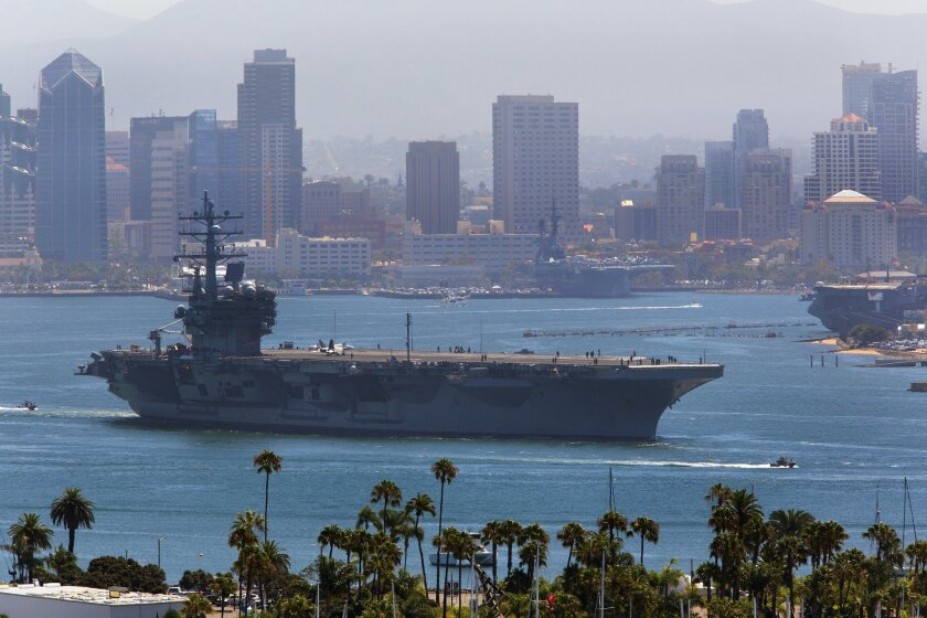 USS Ronald Reagan, a Nimitz-class nuclear-powered supercarrier, leaves San Diego Bay late Wednesday morning as part of preparations for a hull swap with the USS George Washington.