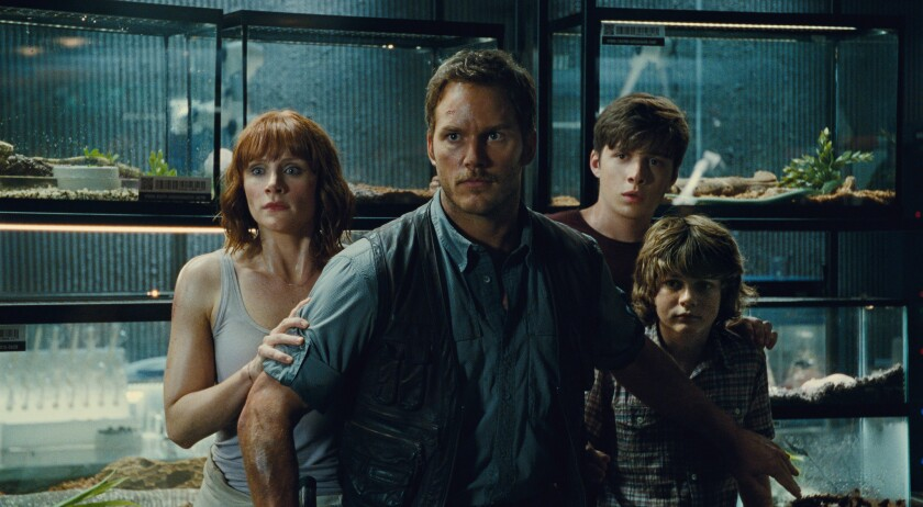 "Bryce Dallas Howard, left, Chris Pratt, Nick Robinson and Ty Simpkins in a scene from 2015's ""Jurassic World."""