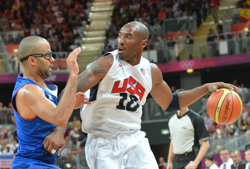 U.S. guard Kobe Bryant is challenged by French guard Tony Parker.