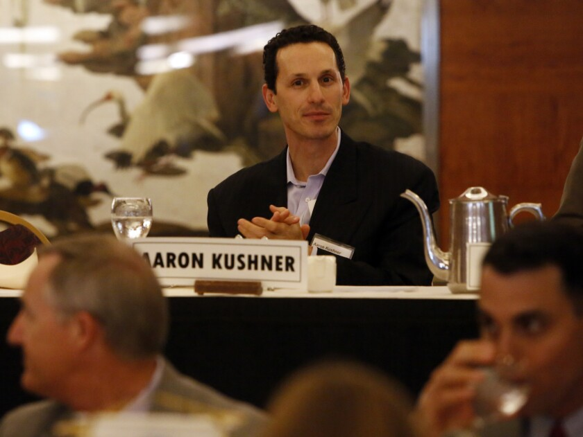 The Los Angeles Times filed a lawsuit against the Orange County Register, owned by Aaron Kushner's Freedom Communications, alleging breach of contract.