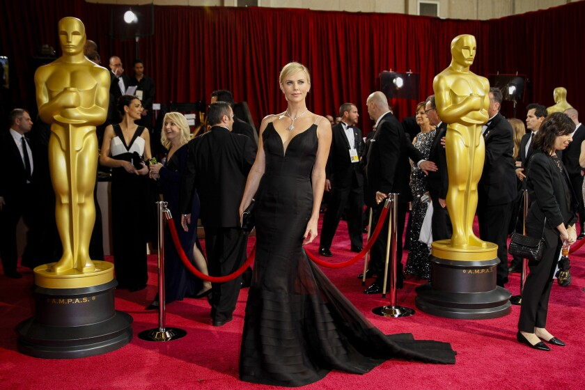 Charlize Theron arrives at the 86th Annual Academy Awards March 2, 2014.