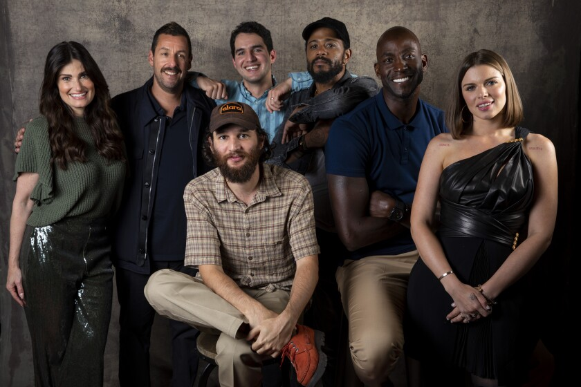 """Actors Idina Menzel and Adam Sandler, directors Benjamin Safdie and Joshua Safdie and actors Lakeith Stanfield, Kevin Garnett and Julia Fox, from the film """"Uncut Gems,"""" photographed in the L.A. Times Photo Studio at the Toronto International Film Festival on Sept. 9."""