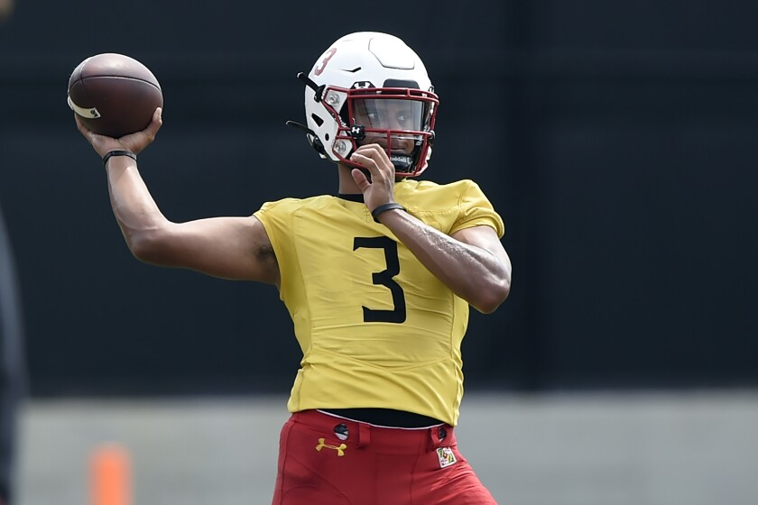 FILE - In this Aug. 6, 2021, file photo, Maryland football quarterback Taulia Tagovailoa throws during NCAA college football practice in College Park, Md. (AP Photo/Gail Burton, File)