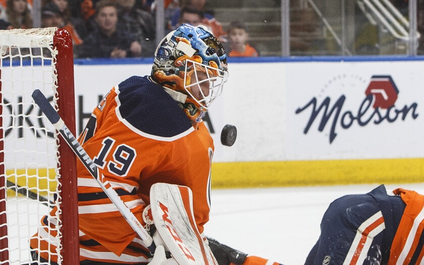 Edmonton Oilers goalie Mikko Koskinen makes a save against the Columbus Blue Jackets during the first period of an NHL hockey game Saturday, March 7, 2020, in Edmonton, Alberta. (Jason Franson/The Canadian Press via AP)