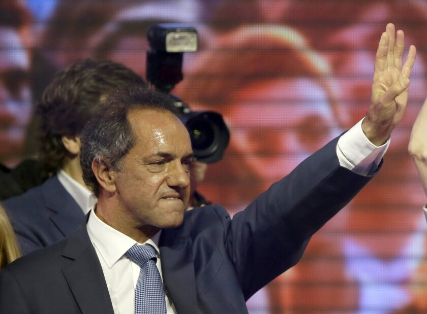 Daniel Scioli, the presidential candidate of Argentina's ruling party, stands on a stage as supporters cheer him on at Luna Park in Buenos Aires on Oct. 25.