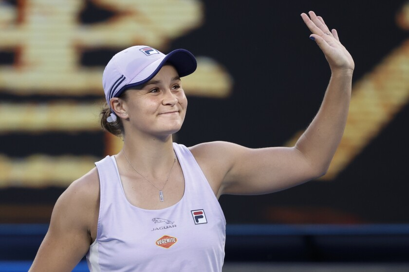 Australia's Ashleigh Barty reacts after defeating Montenegrin's Danke Kovinic during their first round match at the Australian Open tennis championship in Melbourne, Australia, Tuesday, Feb. 9, 2021. (AP Photo/Rick Rycroft)