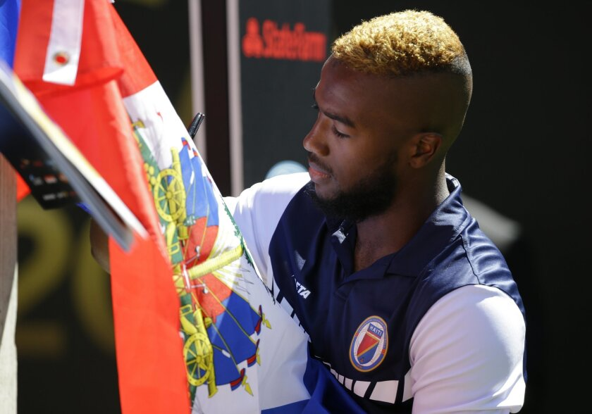 Haiti forward Duckens Nazon signs an autograph before the start of a Copa America Centenario soccer match against Peru, Saturday, June 4, 2016, in at CenturyLink Field in Seattle. (AP Photo/Ted S. Warren)