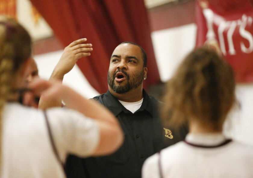 Bishop's head coach Marion Wells talks with his team  as the Bishop's School hosted La Jolla Country Day in girls basketball Wednesday night.