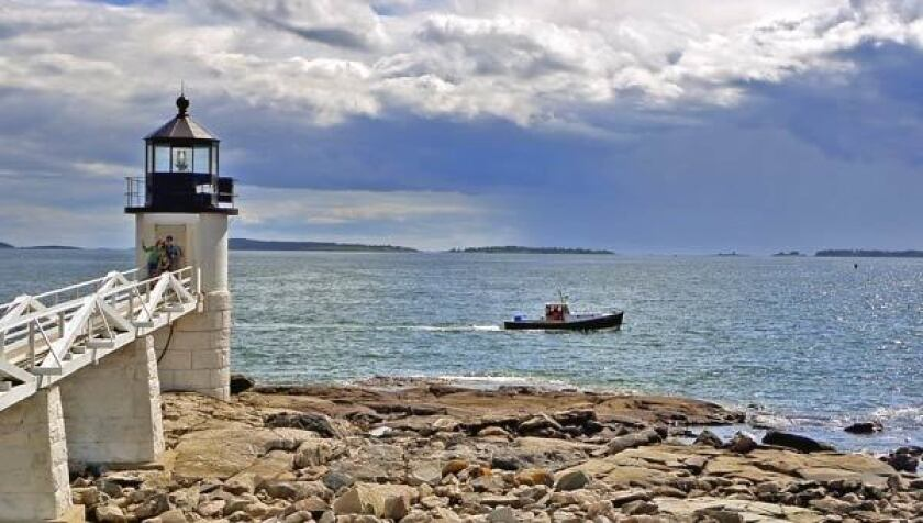 """The Marshall Point Lighthouse is located just five minutes from Port Clyde at the mouth of the St. George River. The lighthouse, which was built in 1858, is under the jurisdiction of the Coast Guard, and the first floor of the lighthouse keeper's house is a museum. The lighthouse was one of the destinations that Tom Hank's character ran to in the movie """"Forrest Gump"""" (1994). On a summer afternoon, the Marshall Point is a perfect location to gaze out across the Atlantic, watch rain squalls drift across the water and mark the progress of a fishing boat as it heads home after a day at sea."""