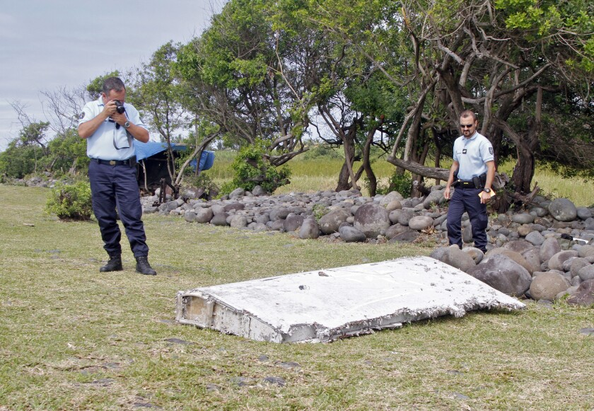 French police officers made an initial examination and documentation of a wing piece found on the Indian Ocean island of Reunion on Wednesday. It appeared to be the first hard evidence that missing Malaysia Airlines Flight 370 crashed more than 16 months ago.