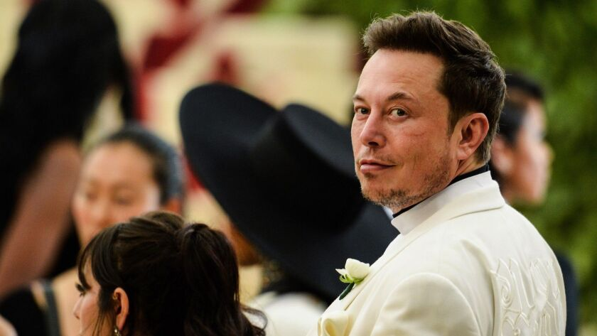 """Elon Musk enters the """"Heavenly Bodies: Fashion and Catholic Imagination""""-themed Met Gala at the Metropolitan Museum in New York City on May 7."""