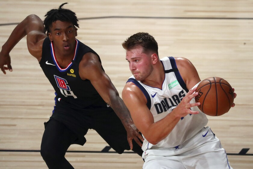 Dallas Mavericks guard Luka Doncic drives to the basket against Clippers guard Terance Mann