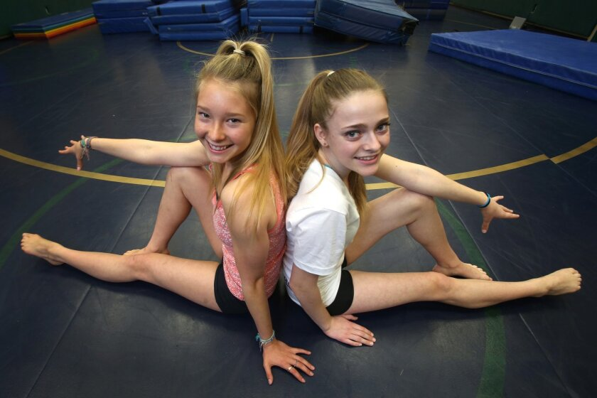 All-around gymnasts Sydney Wennerstrom (left) and Michaela McNaught-Davis Hess have been a part of two San Diego Section team championships at La Costa Canyon.