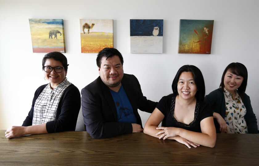 Marie-Reine Velez, left, Peter Kuo, Stefanie Wong Lau and Julia Cho are the founders of Artists at Play, a theater group devoted to producing plays written by Asian Americans.