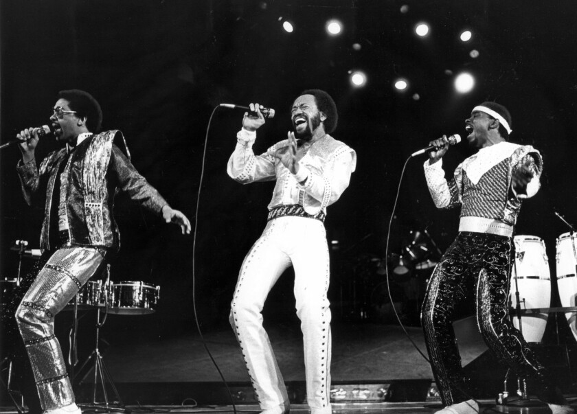 Maurice White, center, leads Earth Wind & Fire at the Forum in Inglewood on Dec. 12, 1981.