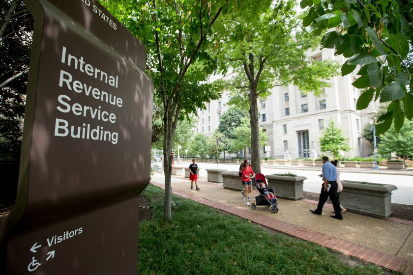 This photo taken Aug. 19, 2015 shows the The Internal Revenue Service (IRS) Building in Washington. No checks, please. If you owe the federal government more than $100 million in taxes, your check is no good at the IRS. Citing technology constraints, the IRS says it will no longer accept checks for