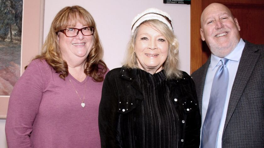 Actress Angie Dickinson (middle) is surrounded by her escorts Paul Brodsky and wife Mary Brodsky. (