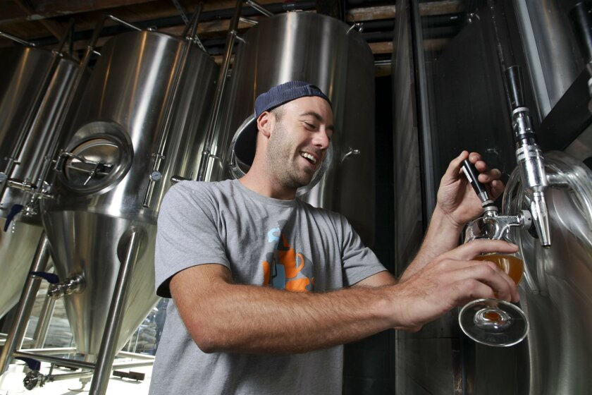 Ryan Hensley, a brewer at Solana Beach's Culture, checks the latest brew.