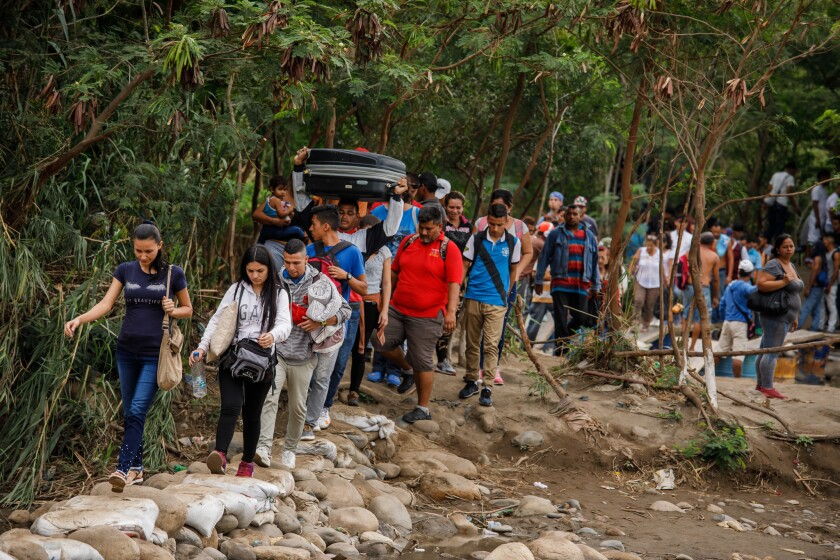 CÚCUTA, NORTE DE SANTANDER -- FRIDAY, MAY 17, 2019: Venezuelans cross the Colombia-Venezuela border