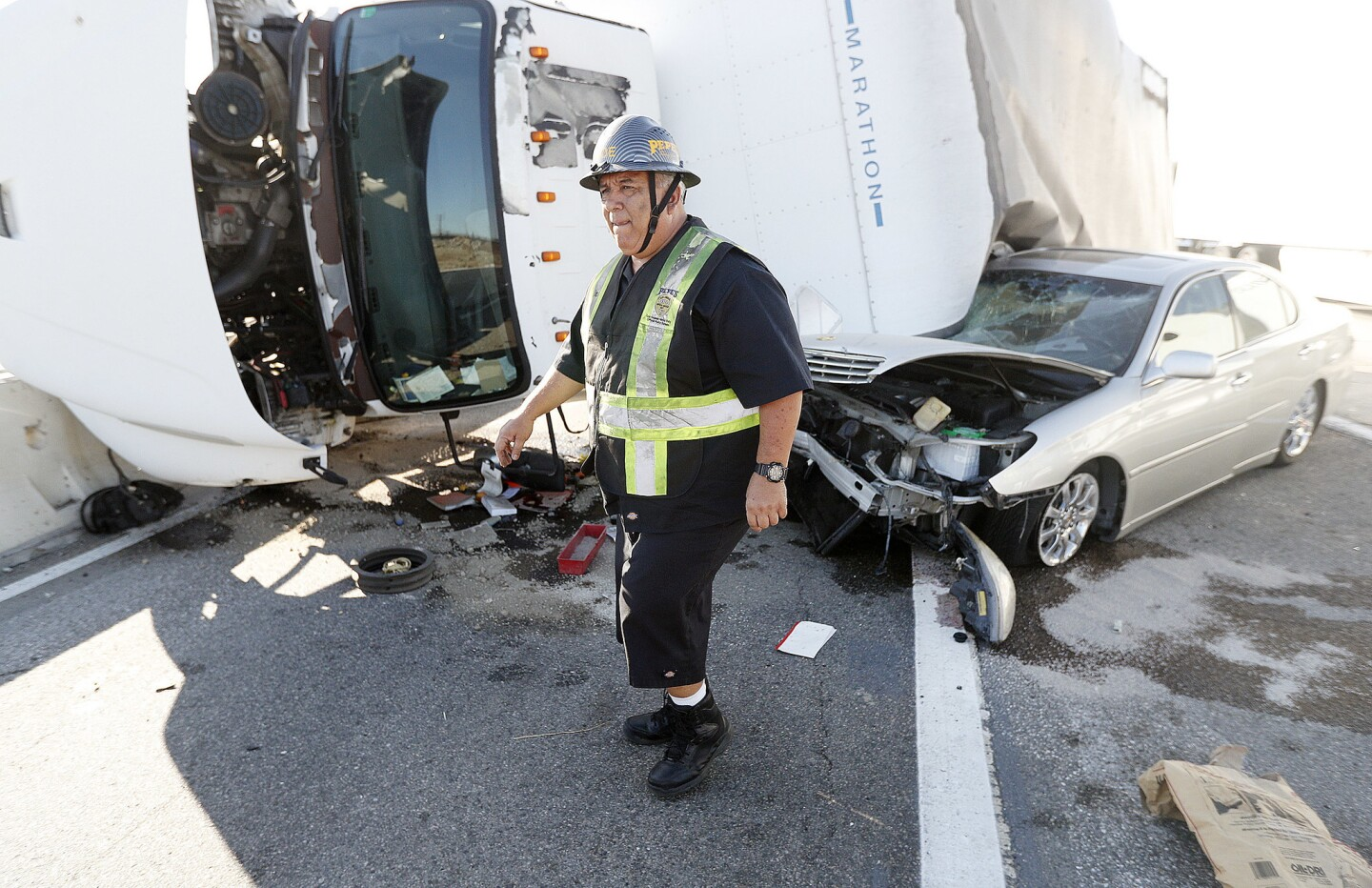 Photo Gallery: Box truck and car tangle at southbound Interstate 5 exit at Burbank Boulevard