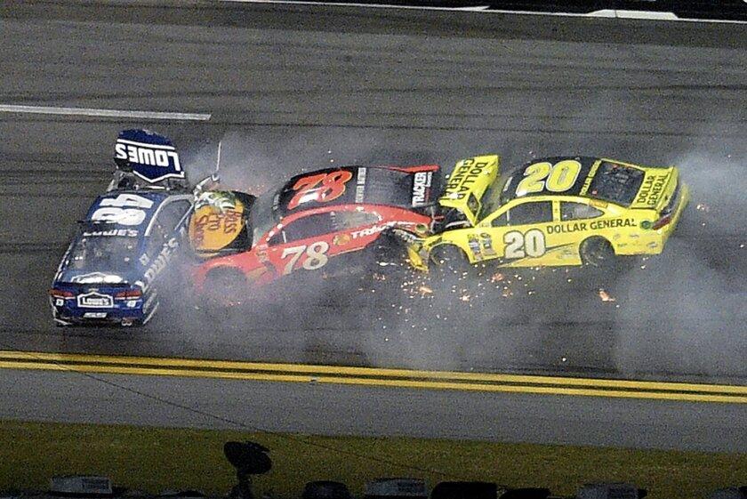 Jimmie Johnson (48), Martin Truex Jr. (78) and Matt Kenseth (20) collide during the second of two qualifying races for Sunday's NASCAR Sprint Cup Series Daytona 500 auto race, Thursday, Feb. 18, 2016, in Daytona Beach, Fla. (AP Photo/Phelan M. Ebenhack)