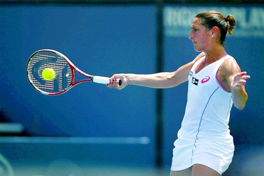 Virginie Razzano hits a forehand to Petra Kvitova during their quarterfinal match, won by Razzano.