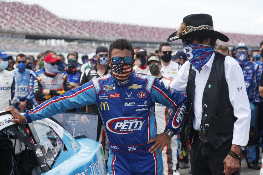 NASCAR driver Bubba Wallace, left, and team owner Richard Petty.
